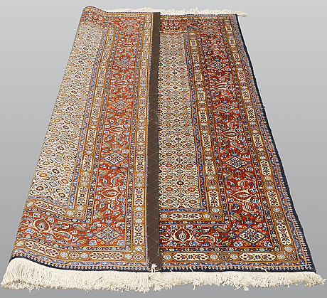 A rug, moud, signed, ca 252 x 150 cm.