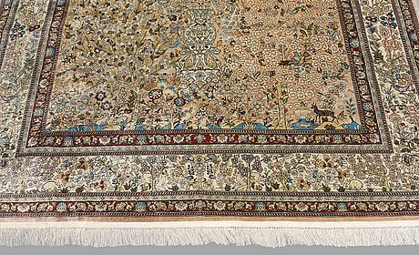A rug, oriental figural silk, ca 274 x 186 cm.