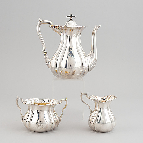 A swedish parcel-gilt coffee pot, creamer and suga bowl.