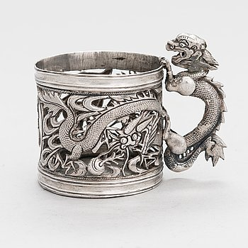 A silver, dragon motif tea glass holder, Shanghai, China around the turn of the 20th Century. Unidentified marks.