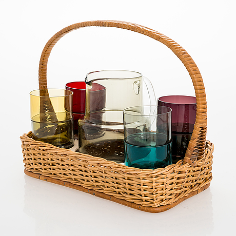 Saara hopea, a glass pitcher and six glasses in rattan basket, for nuutajärvi. designed year 1952.