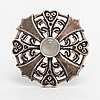 "Kaisaleena mäkelä, a silver pendant/brooch ""kuukiven koru"" with a moonestone. kalevala koru, helsinki 1997."