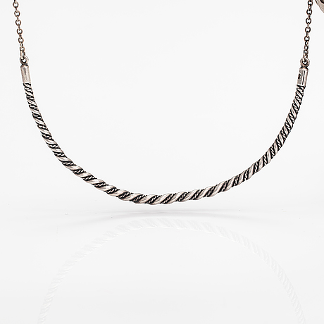 "A sterling silver necklace ""twined jewellery from lampola in halikko"". kalevala koru, helsinki 1992."
