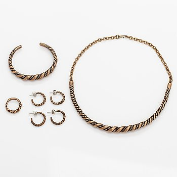 A set with a bronze necklace, bracelet, ring and two pairs of earrings. Kalevala koru, Helsinki.