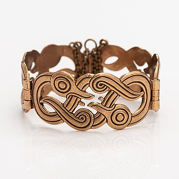 "Germund Paaer, A bronze bracelet ""Iku-Turso"". Kalevala koru, Helsinki."