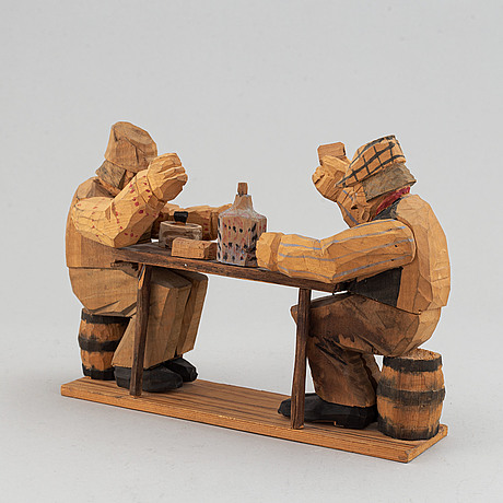 A carved wooden sculpture, signed and dated 1920.