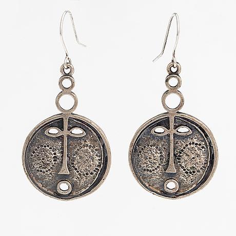 "Jorma laine, a pair of sterling silver earrings ""face mask"". turun hopea, turku."