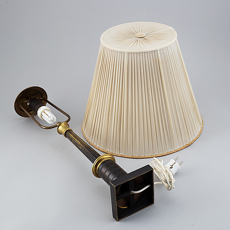 An empire style table lamp from the first half of the 20th century.