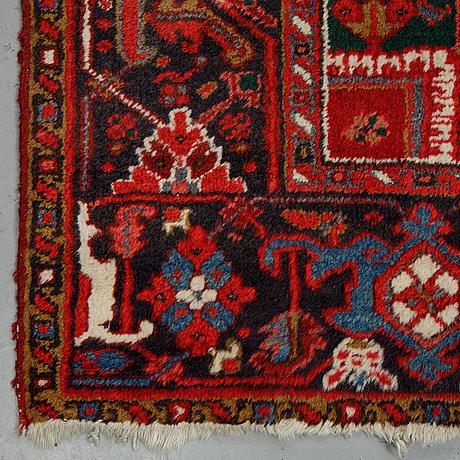 A carpet, semi-antique/old heriz, ca 340 x 256 cm.