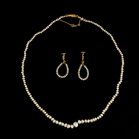 A pearl necklace and a pair of pearl earrings.