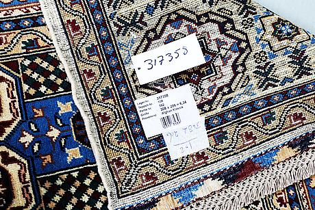 A carpet, kazak design, ca 308 x 206 cm.