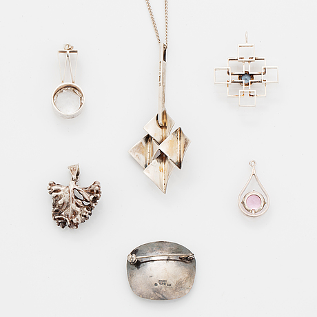 Five pendants and one brooch, silver.