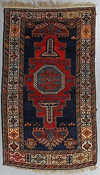 A rug, a semi-antique Shirvan, ca 196,5-201,5 x 117-122 cm.