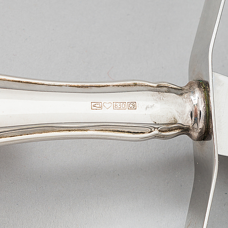 A 56-piece 'chippendale' silver cutlery set in a wooden cutlery box, finnish hallmarks 1957-2004.