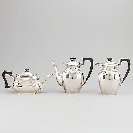 A silver teapot, coffee pot and a hot water pot, including atkins brothers, sheffield 1944.
