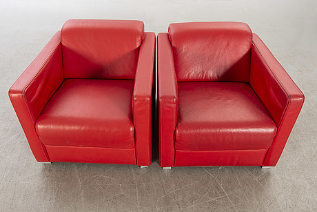 A pair of italian 1990's leather armchairs.