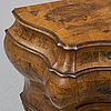 A 20th century louis xv-style chest of drawers.