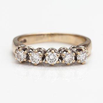 An 18K gold ring with diamonds ca. 0.40 ct in total. Harri Lahtinen, Helsinki 1988.