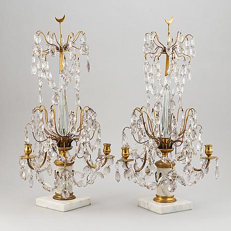 A pair of gustavian style three-light girandoles, early 20th century.