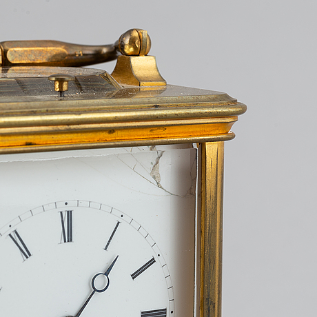 A french aiguilles gilt brass carriage clock, turn of the century 1900.