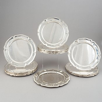 A 20th century set of 24 silver 925/1000 plates, marked Mexico.