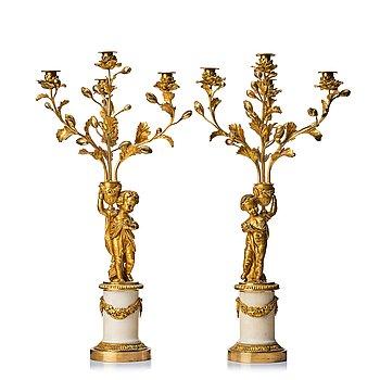 111. A pair of Louis XVI four light candelabra.