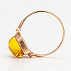 A 14k gold ring with an amber. sovjet union.