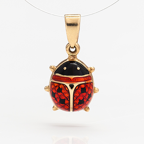 A 14k gold and enamel pendant.