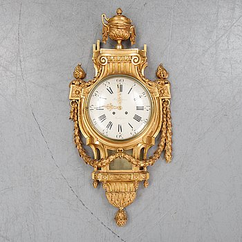 A gustavian style wall clock, signed Rob. Engström, Stockholm. First half of the 20th century.