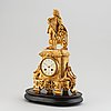 A late 19th century pendulum clock. wooden plinth included.