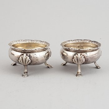 Two pairs of English 18th century silver salt-cellars, marked in London 1762 and 1769.