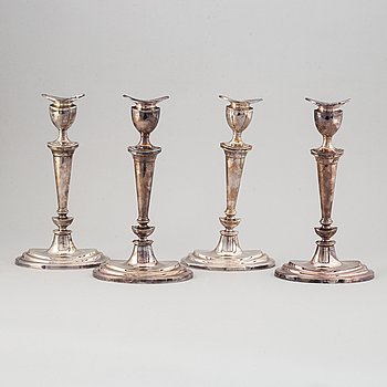 A set of four English 19th century silver-plated candlesticks.