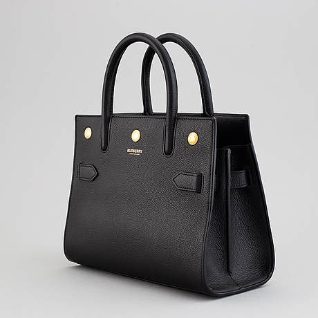 Burberry, a black leather 'baby title' handbag, 2019.