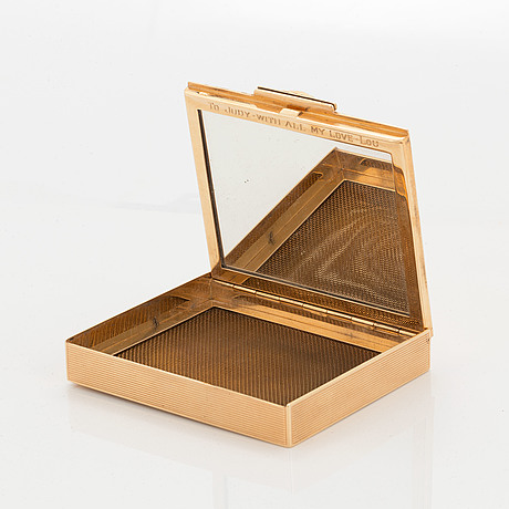 14k gold and ruby vanity case.