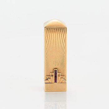 14K gold and ruby gold lipstick case.