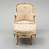 A louis xv-style bergère armchair with stool, second half of the 19th century.