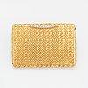 18k gold and diamond vanity case.
