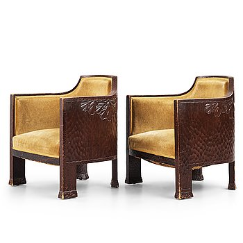 276. Otto Wretling, attributed to, a pair of Art Nouveau carved pine easy chairs,