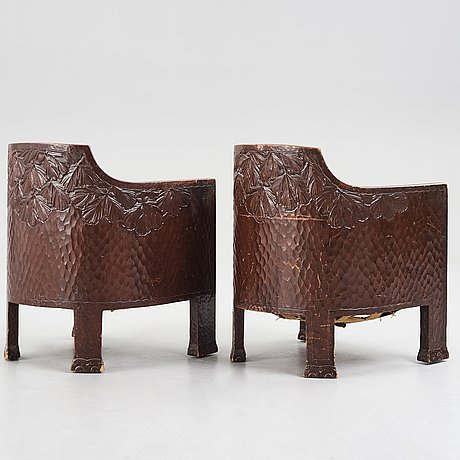 Otto wretling, attributed to, a pair of art nouveau carved pine easy chairs,