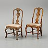 Twelve matched late baroque style chairs, first half of the 18th century.