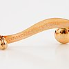 Design elon arenhill, 18k gold and pearl brooch.