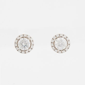 A pair of 18K white gold earrings.