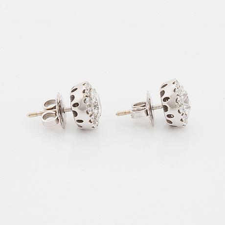 A pair of 18k white gold earrings.