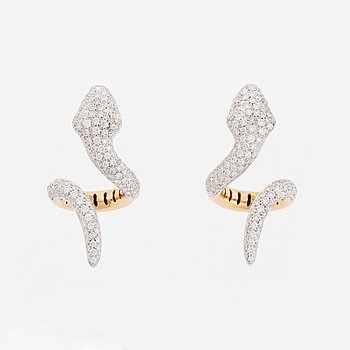 A pair of snake earrings.