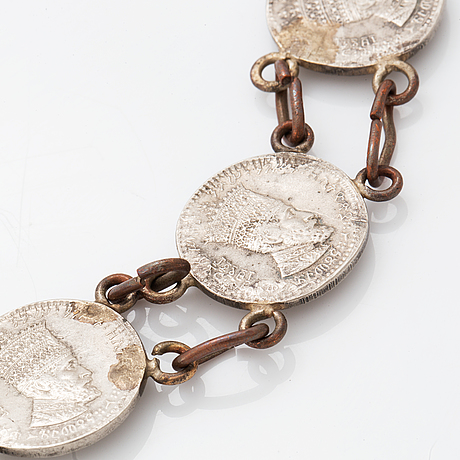 Necklace and brooch with coins.