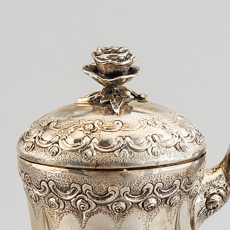A rococo-style coffee pot, creamer and sugar bowl, swedish import mark, 20th century.