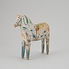 A painted swedish wooden horse from the early 20th century.