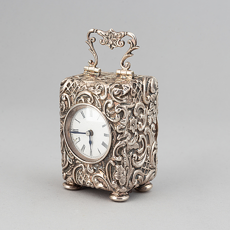 A rococo-style silver clock, mark of henry matthews, chester 1903.