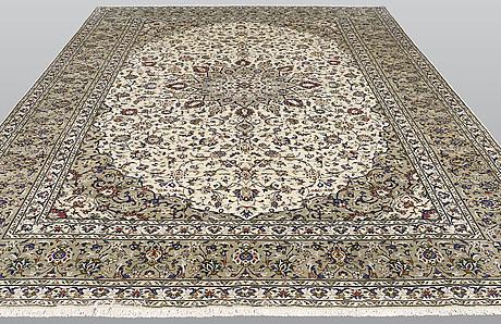 A carpet, kashan, ca 405 x 298 cm.