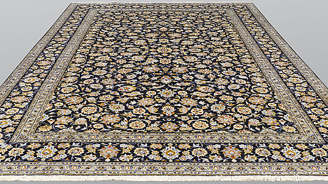 A carpet, kashan, signed, ca 410 x 300 cm.